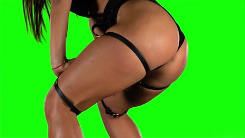 Girl sexy moving her ass dancing twerk. Green. Closeup