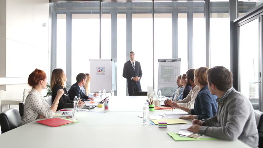 Business people applauding director during a meeting in conference room | Shutterstock HD Video #15414883