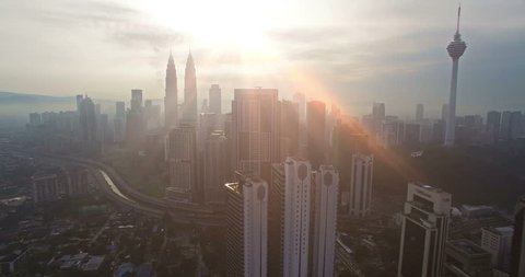 Aerial view of Kuala Lumpur city in Malaysia capital, tall buildings. Cinematic video of skyscrapers in big City.