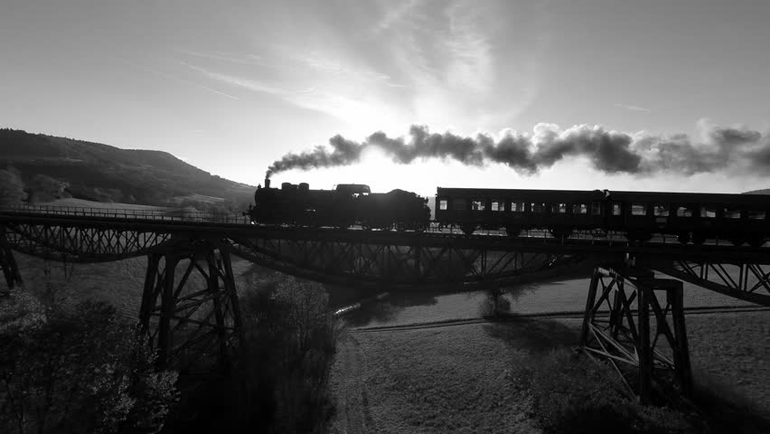 Steam engine locomotive on railroad track. old historical train. nostalgic romantic background