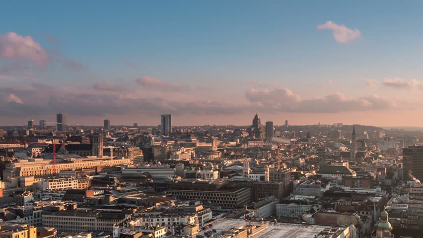 time lapse of brussels skyline from day to night zoom out