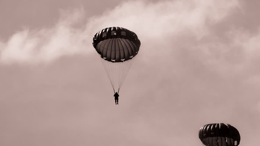 World War II paratroopers dropping into battlefield during war. 4K
