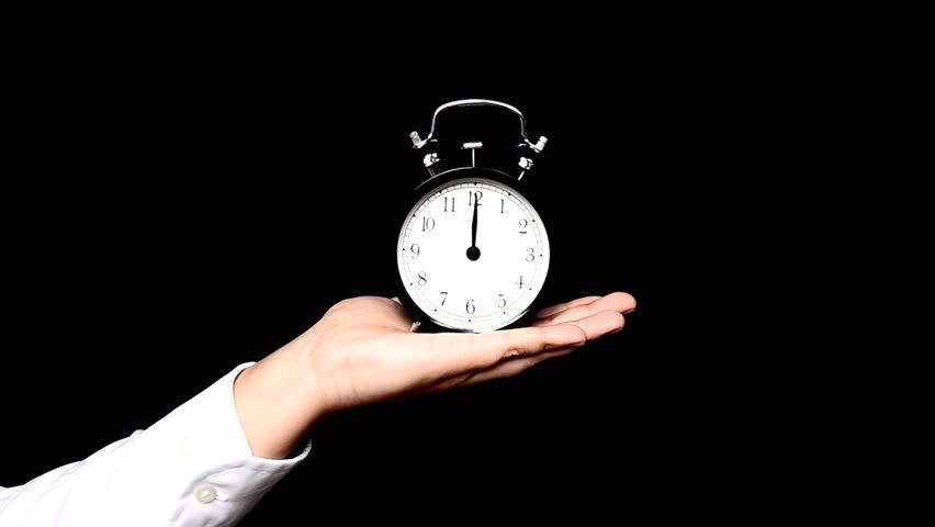 stock video of hand hold alarm clock to keep 15463303 shutterstock. Black Bedroom Furniture Sets. Home Design Ideas