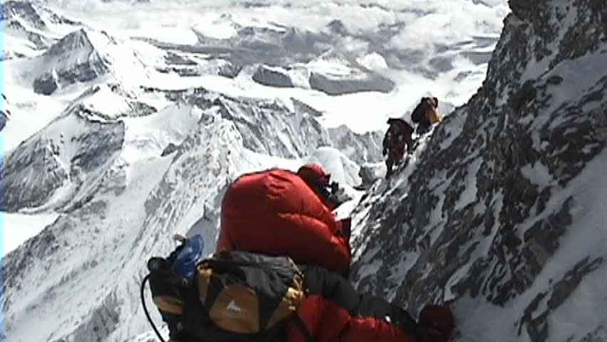 In the death zone climbing towards the summit of Everest - Climbers navigate difficult, scary terrain