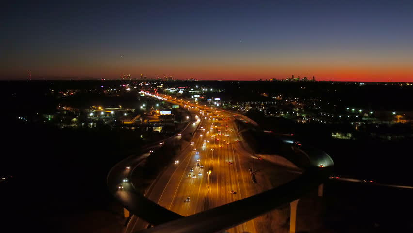 Atlanta Aerial v233 Flying low backwards following over Spaghetti Junction freeways at night, pan down.