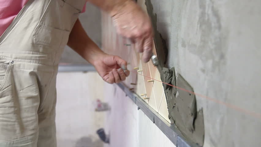 Installing Ceramic Tile Lying Mortar To A Kitchen Wall Close Up