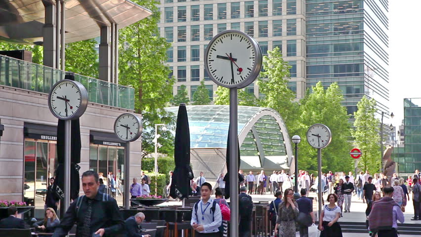 LONDON, UK - JULY 03, 2014:  Office people walking via main square to work in early morning. Canary Wharf business and banking aria | Shutterstock HD Video #15517924