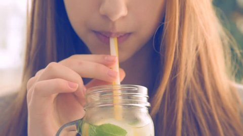Girl drinking lemonade.
