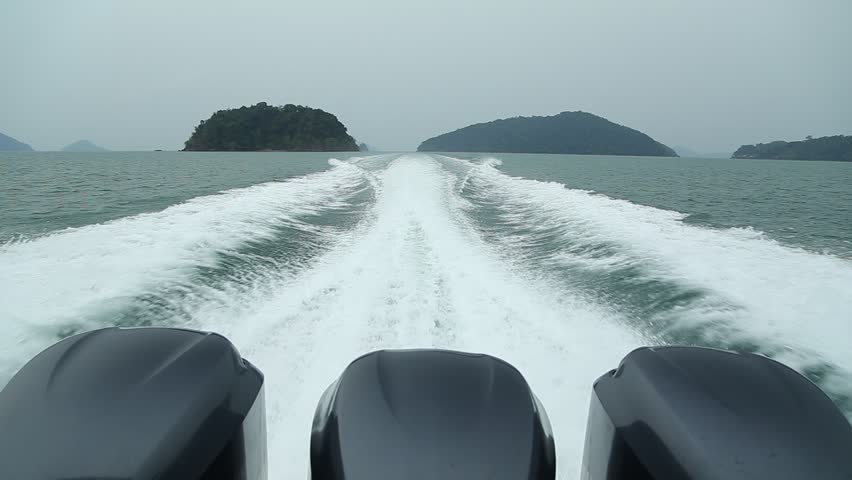 Rear view of motor speed boat on open sea at high speed | Shutterstock HD Video #15553273
