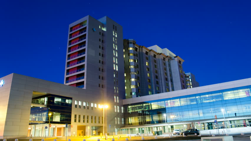 Generic Health Care Modern Hospital Exterior Building at night. Time Lapse