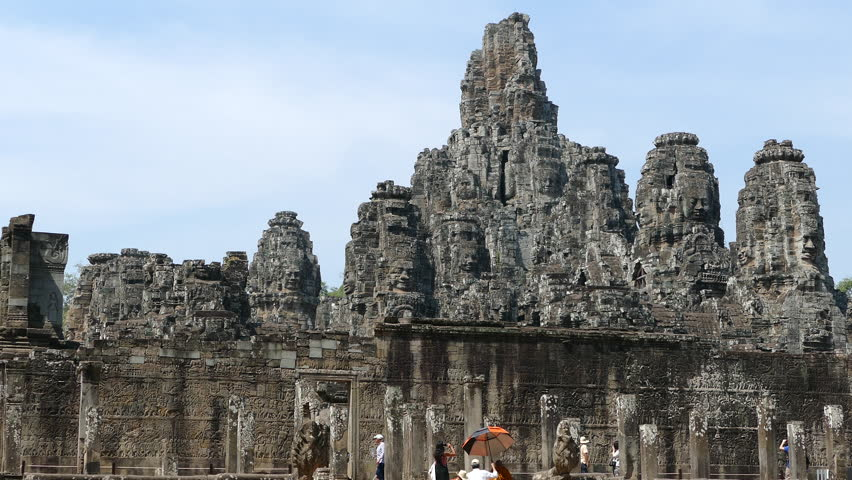 Monk and other tourists walking at the Bayon Khmer temple at Angkor Wat Cambodia #15616933