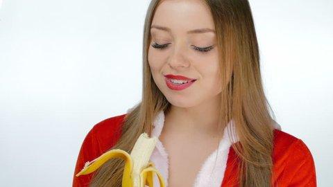 Young girl sexy eating a banana