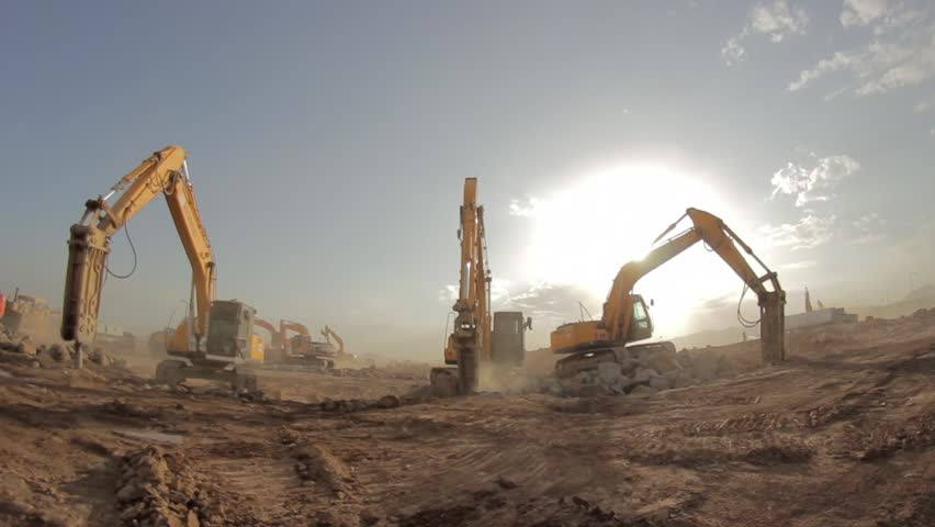 Madina - Saudi Arabia 8 December 2014- Hydraulic hammer breaker on excavator destroying rocks - Fish Eye