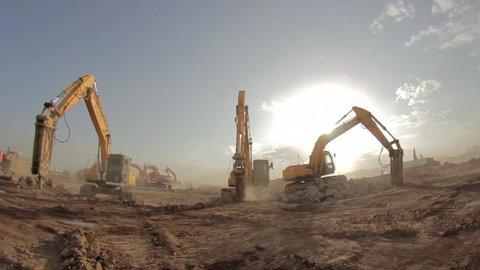 Madina - Saudi Arabia 8 December 2014- Hydraulic hammer breaker on excavator destroying rocks - Fish Eye