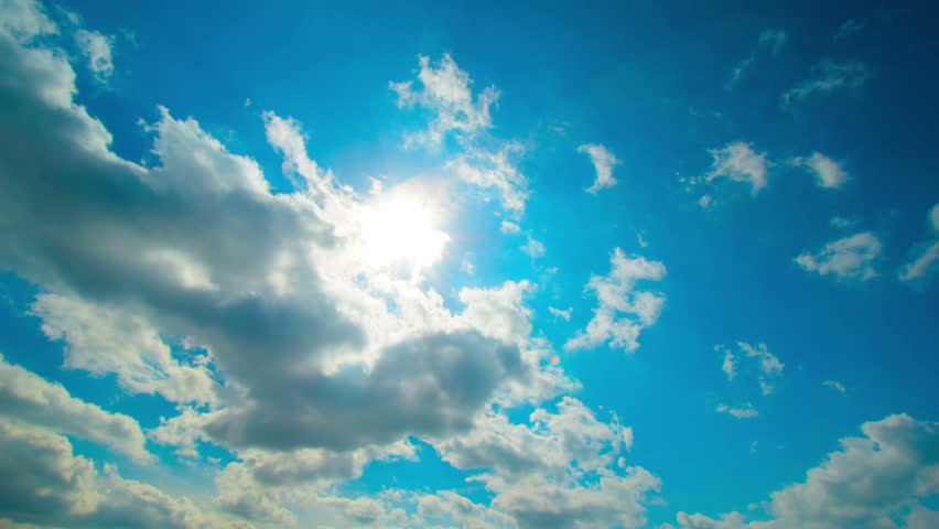 Clouds background. Cloudscape, sun rays, blue sky. Clouds timelapse, fast motion of clouds at blue sky in summer day. Sky background with small clouds and bright blue sky. Full HD, 4K video footage.