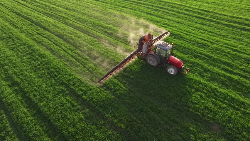 Aerial view of tractor spraying wheat field | Shutterstock HD Video #15649297