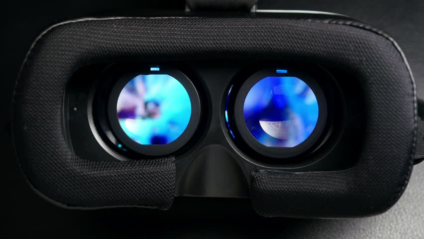 Virtual reality mask. Close up. A virtual reality headset affords an immersive graphical experience. 4K UHD video.