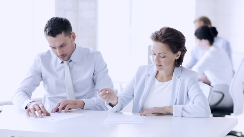 Business and office - man and woman signing a contract | Shutterstock HD Video #15657163