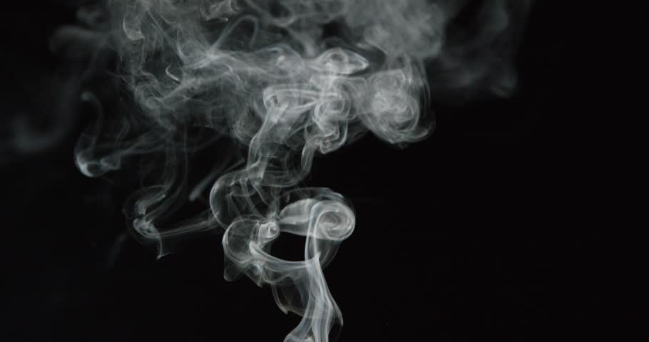 Clouds of white smoke rise into frame from a fire or candle in slow motion on black background, ALPHA MATTE