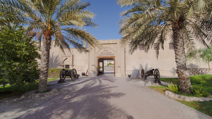 AJMAN, UAE - SEPTEMBER 14: Historic fort at the Museum of Ajman timelapse hyperlapse with blue cloudy sky, United Arab Emirates 4K
