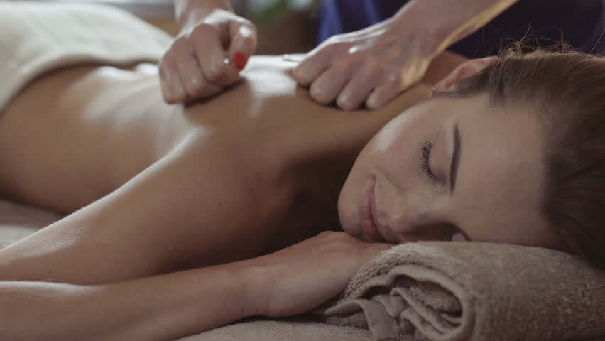 Massage concept. Beautiful young woman reciving relxing massage-