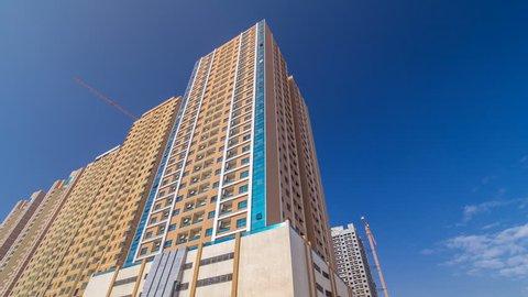 AJMAN, UAE - DECEMBER 15: Emirates towers. Modern new towers in Ajman timelapse hyperlapse. Cityscape of Ajman. Ajman is the capital of the emirate of Ajman in the United Arab Emirates. 4K