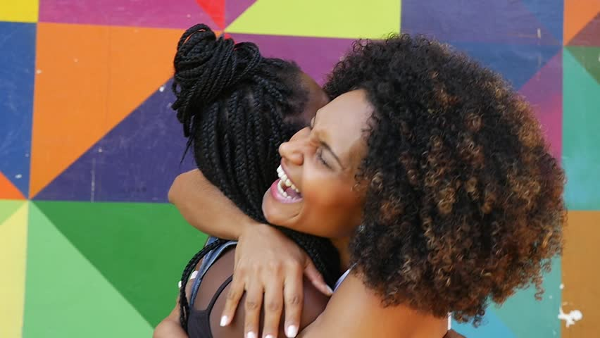 Women meeting and hugging on the park, slow motion