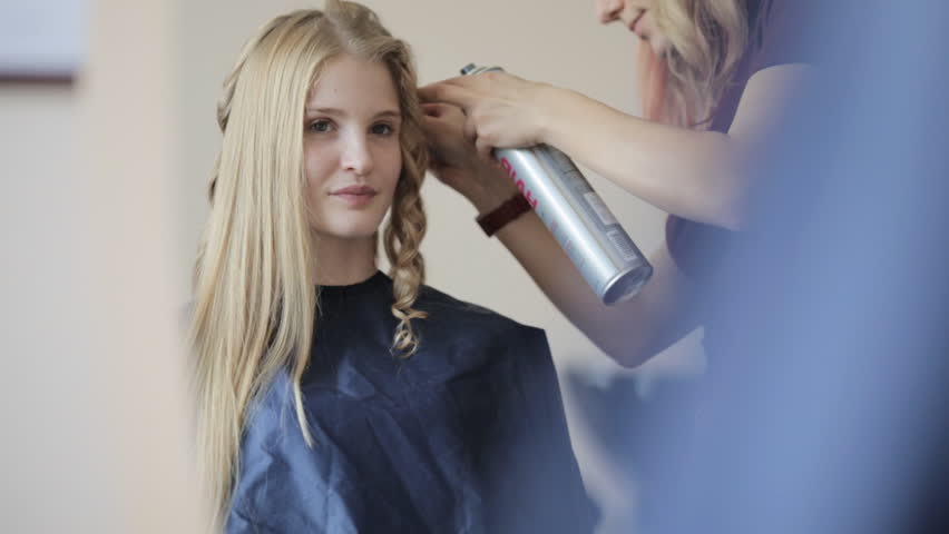 young model is preparing for a fashion show in the beauty salon