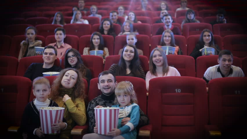 it seems to be a funny movie friends in cinema watching a