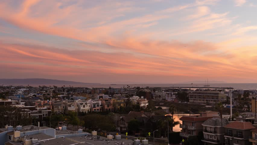 Rooftop Sunset in Marina Del Rey View from a rooftop in Marina Del Rey of Venice Beach south toward LAX | Shutterstock HD Video #15765943