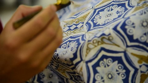 Detail of waxing the drawing to textile for making batik