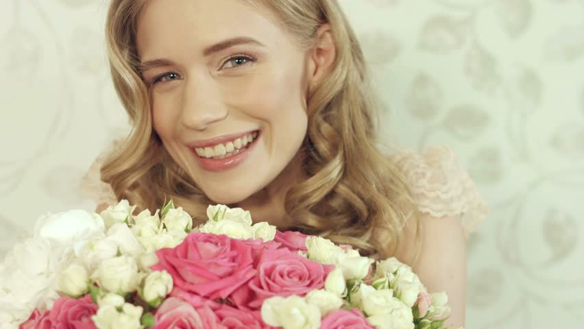 Enthusiastic girl posing with a big and beautiful bouquet of small roses  #15809713