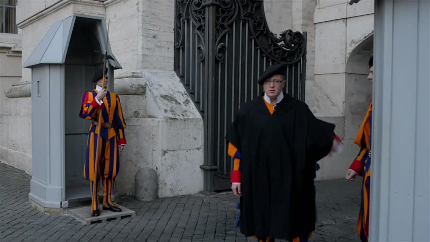 VATICAN CITY - JANUARY 24 2016: Swiss Guard posted at St. Peters Basilica, Vatican City. Name Swiss Guard generally refers to Pontifical Swiss Guard of Holy See stationed at Vatican in Rome. #15843703