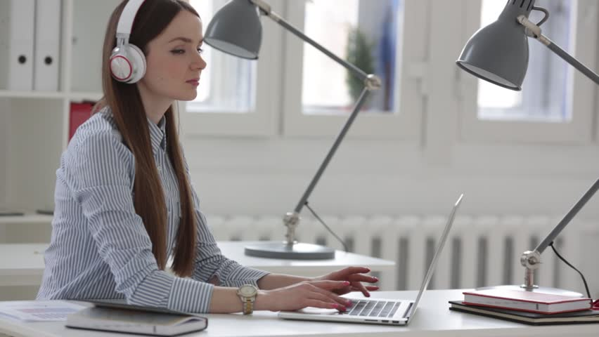 Woman working with documents in the office | Shutterstock HD Video #15852478