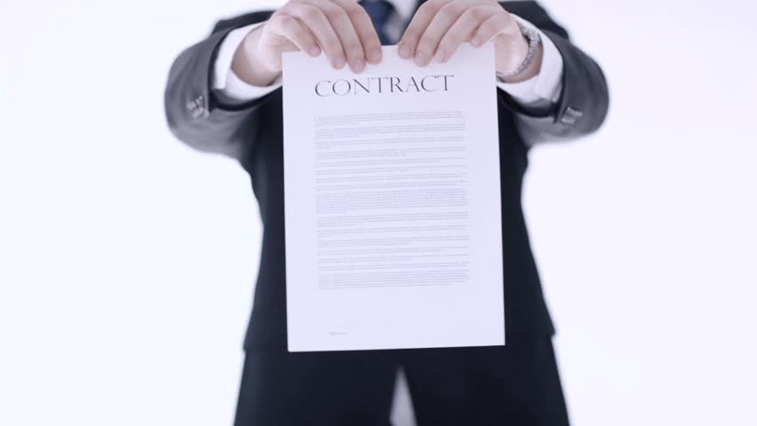 man in suit and tie breaking a contract