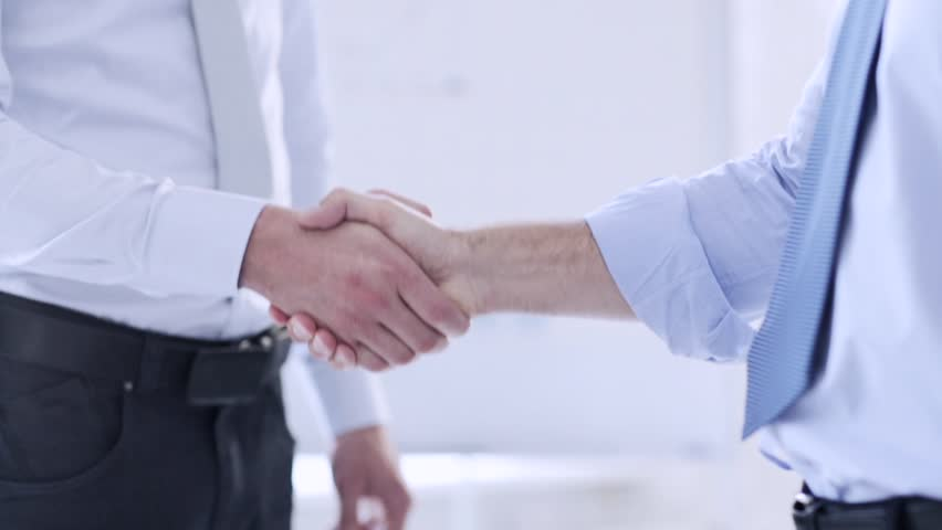 Business handshake - two businessmen shaking their hands | Shutterstock HD Video #15880963