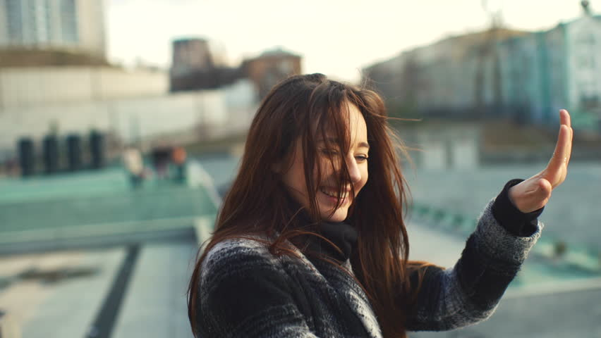 Young Woman Waving , Smiling , Glad , Meeting With Friends , the Joy of Meeting , to Pull the Plug , he Said Long Dark Hair Develops Wind 4k | Shutterstock HD Video #15921703