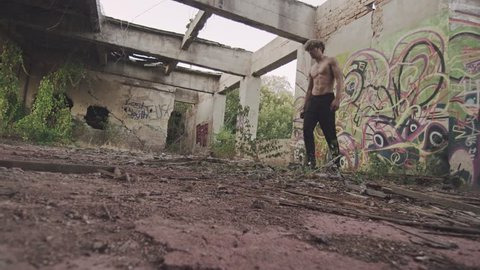 Parkour and Freerunning pro does a huge frontflip drop from one floor to the other.
