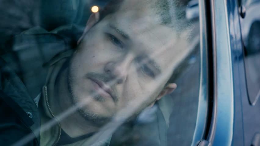 Broken young man in a car after drug assunction   Shutterstock HD Video #15968653