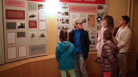 SAMARA - MAY, 8, 2015: Information boards with photo of Kuibyshev and visitors in Stalins bunker in Samara. One of most intriguing museums devoted to Great Patriotic War - Stalins bunker in Samara.