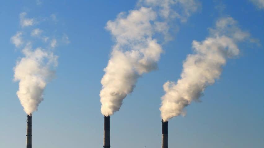 Smoke stack on blue sky background