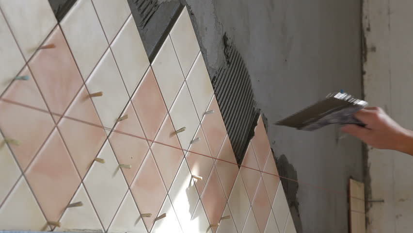 Man S Hands Installing Ceramic Tile To A Kitchen Wall Close Up Hd Stock