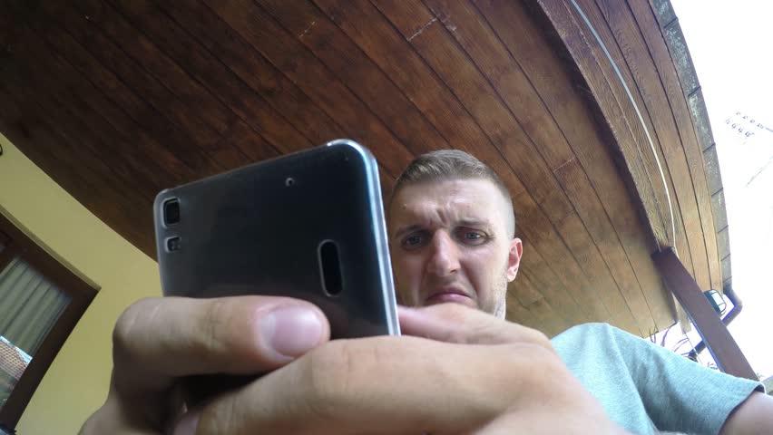 Closeup Crazy Funny Man Texting on Smart Phone. 4K.