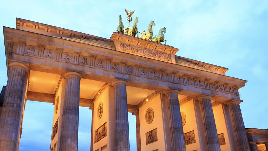 Hyperlapse closeup or motion time lapse of the Brandenburg Gate Landmark (Brandenburger Tor) by Pariser Platz in Berlin, Germany at night. 4k (4096x2304).  Relevant to coronavirus, covid-19.   Shutterstock HD Video #16023943