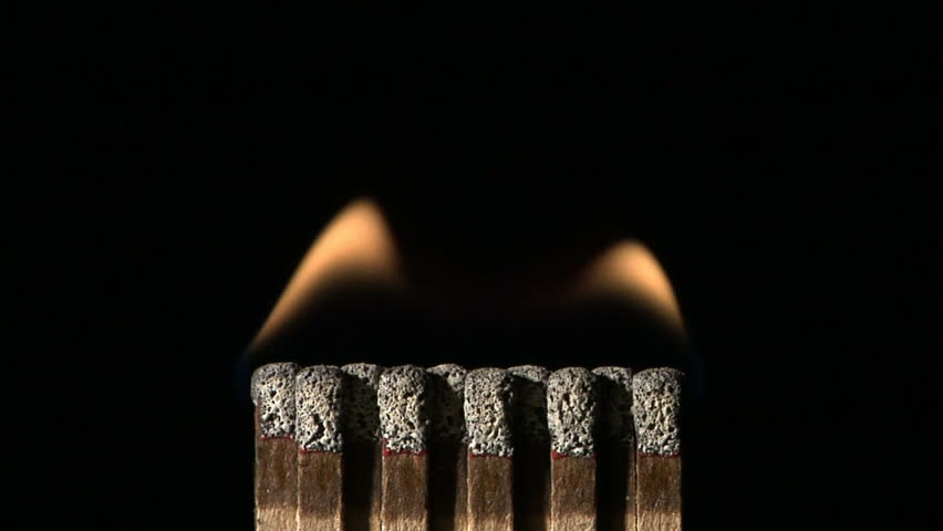 CU - Book of matches ignite on fire against black background