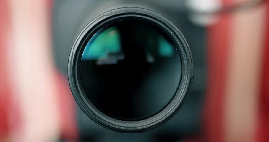 Defocussed Camera Lens Zooms into Focus - Photographer / Camera Operator Working