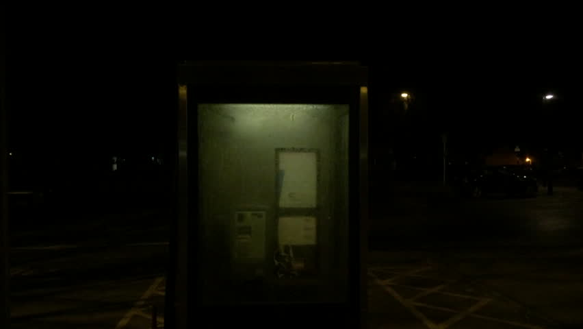 The light in an empty public phone box flickers mysteriously at night | Shutterstock HD Video #16059733