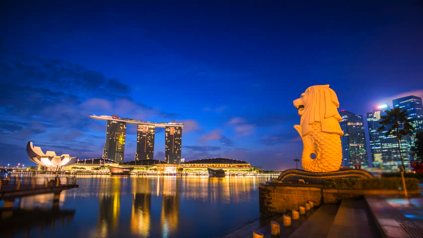 SINGAPORE - FEBRUARY 14: Time lapse Sunrise at Singapore city landmark Merlion The Merlion Statue with the City Skyline in the background, Marina Bay on February 14,2016 in Singapore
