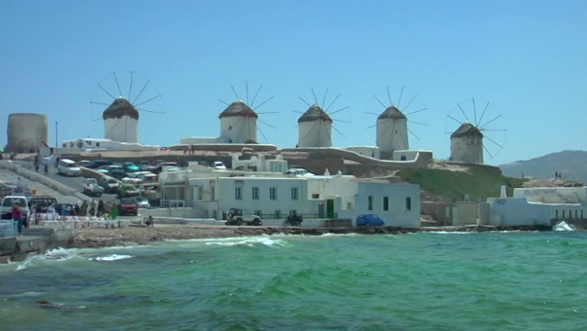 Shot of windmills by shore of Mykonos, Greece