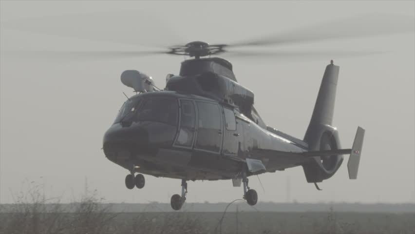 Black large helicopter coming in for landing - Slow motion Slog3 scene